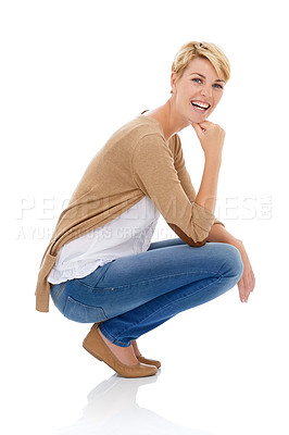 Buy stock photo A pretty young woman crouching in casual wear while isolated on a white background