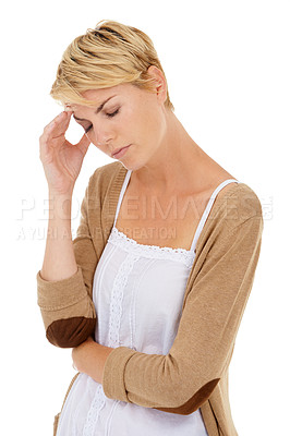 Buy stock photo A young woman suffering from a headache brought on by her fast-paced modern lifestyle