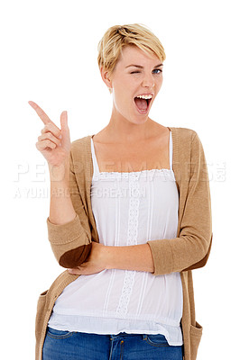 Buy stock photo A pretty young woman pointing at copyspace and winking at you while isolated on white