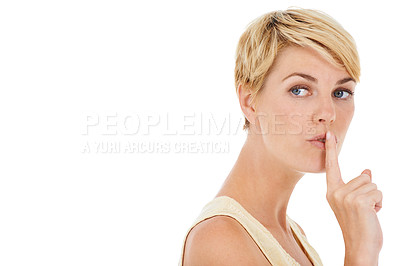 Buy stock photo A pretty young woman putting a finger to her lips while isolated on a white background