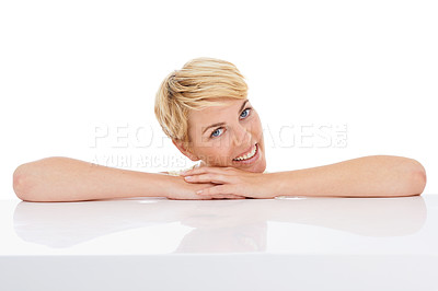 Buy stock photo Portrait of a pretty young woman resting on her hands while isolated on white