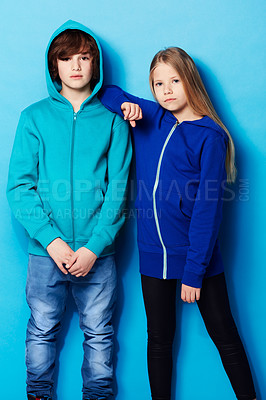 Buy stock photo Portrait of a young boy and a young girl in the studio