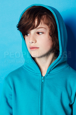 Buy stock photo Shot of a young boy against a blue background