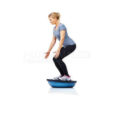 Buy stock photo A beautiful young woman working out on an upside-down bosu-ball