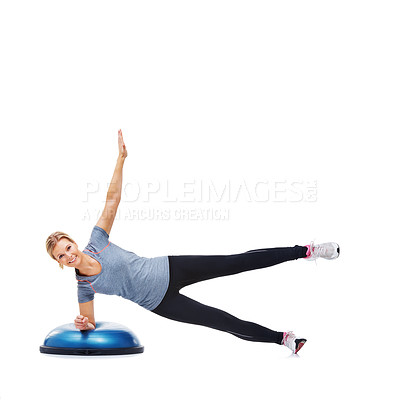 Buy stock photo Portrait of an attractive young woman using a bosu-ball for an upper body workout