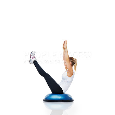 Buy stock photo A young woman using a bosu ball for a workout