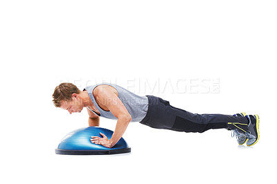 Buy stock photo A young man working his upper body using a bosu-ball