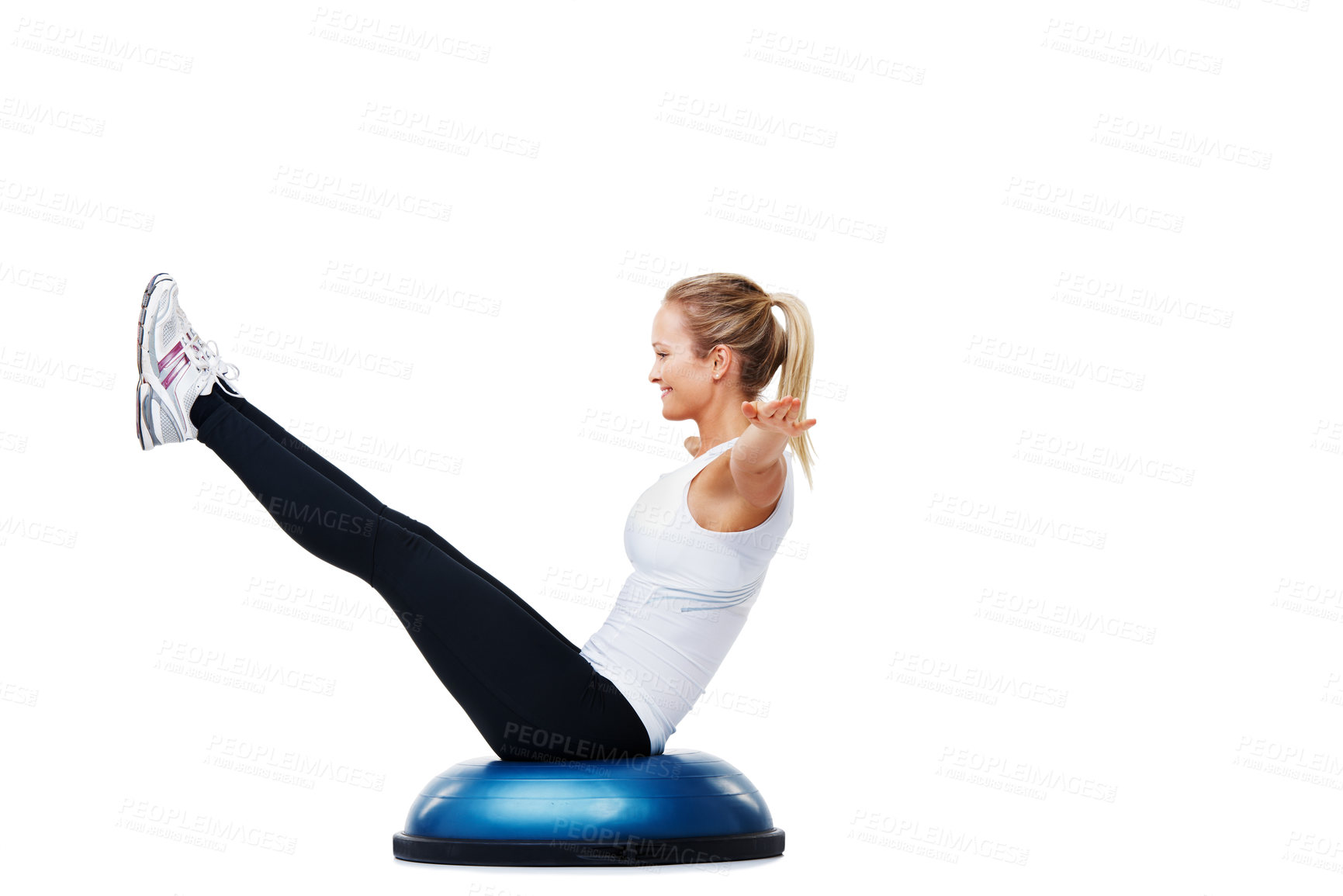 Buy stock photo A young woman balancing on a bosu-ball