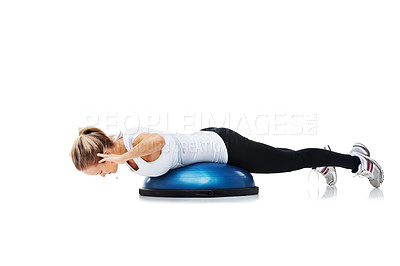Buy stock photo A young woman working out using a bosu-ball