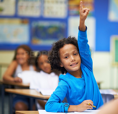 Buy stock photo A little boy raising her hand in class