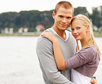 Cute young couple embracing at the seaside