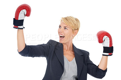 Buy stock photo A young woman looking excited while wearing boxing gloves