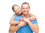 Cute young couple embracing on white background