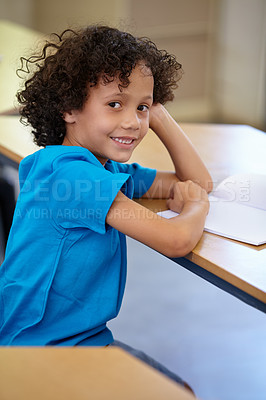 Buy stock photo Portrait of a cute ethnic boy sitting in his classroom