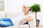 Happy young  man listening to music in the comfort of his home