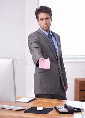Buy stock photo A young businessman giving you a notice