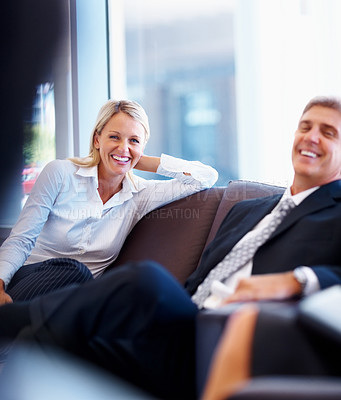Satisfied business executives having fun during conversation