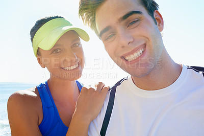 Buy stock photo Portrait of a young athletic couple standing outside