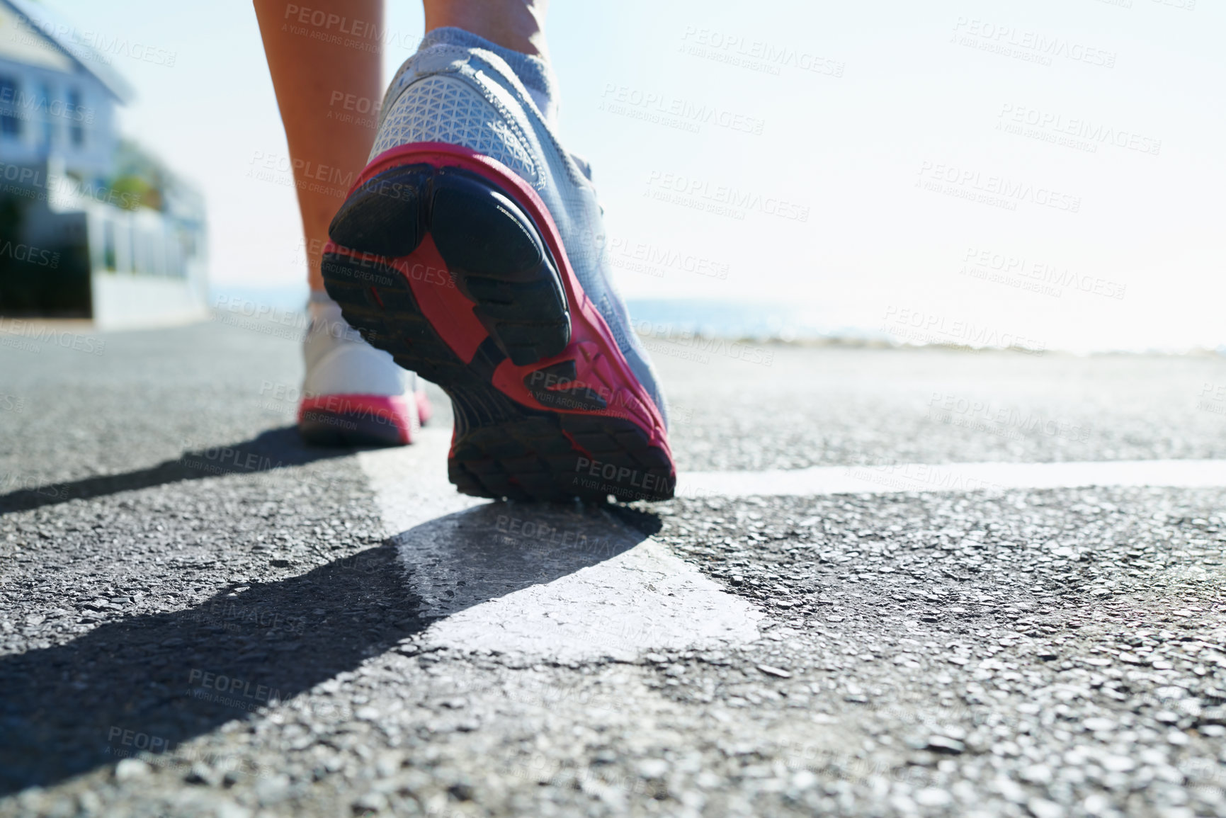 Buy stock photo Cropped shot of an athletic young woman's running shoes
