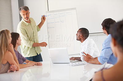 Buy stock photo Businesspeople listening to a presentation