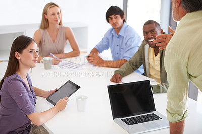 Buy stock photo A team of coworkers at a creative agency brainstorming for a new project in the boardroom