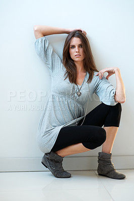 Buy stock photo Lovely young woman posing against white