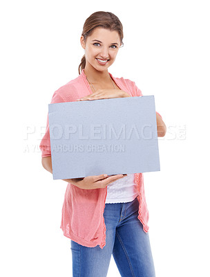 Buy stock photo A gorgeous young woman holding a placard while isolated on a white background
