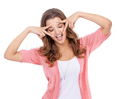 Buy stock photo A young woman posing playfully with her fingers by her eyes