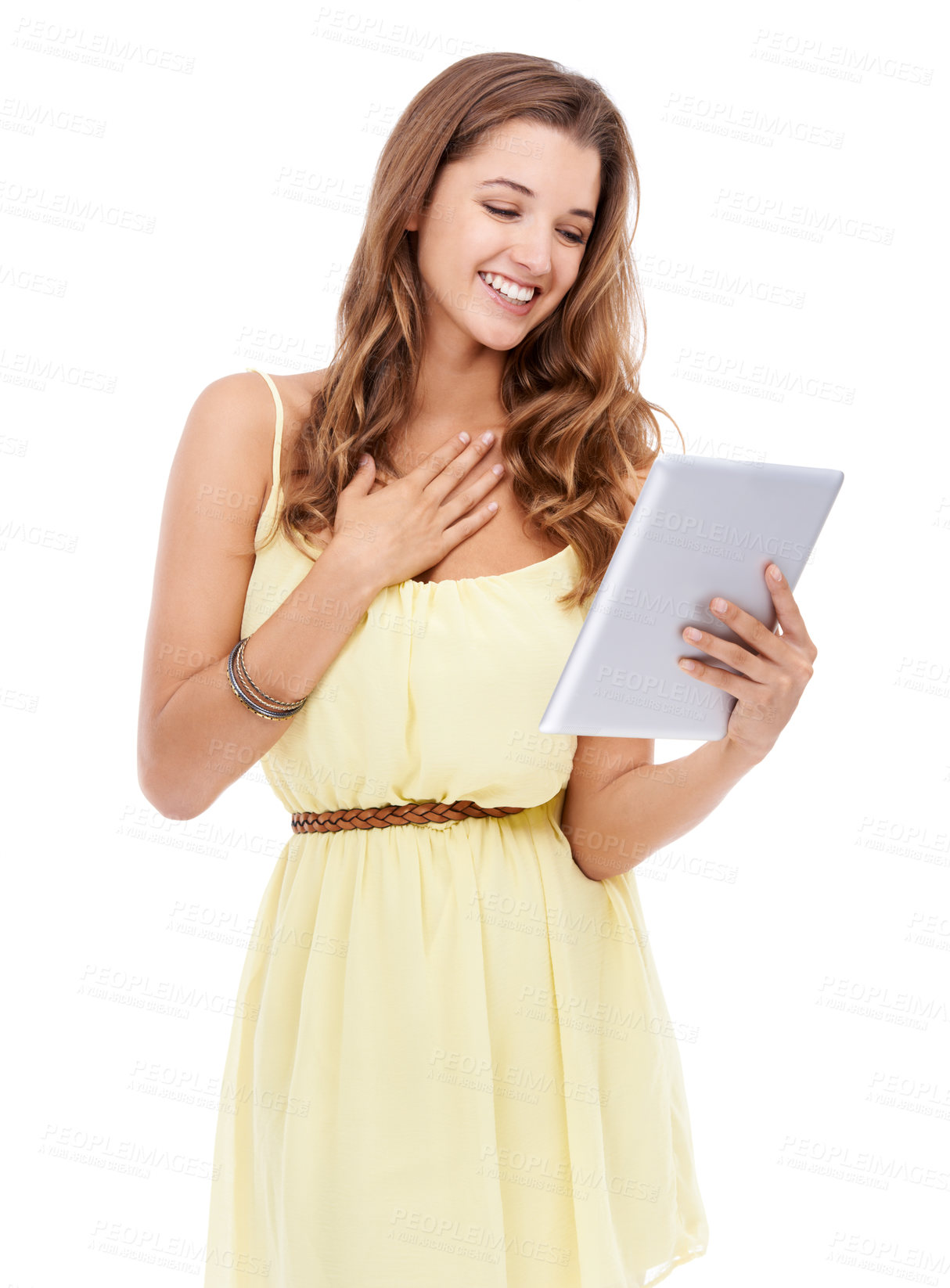 Buy stock photo An attractive young woman holding a digital tablet