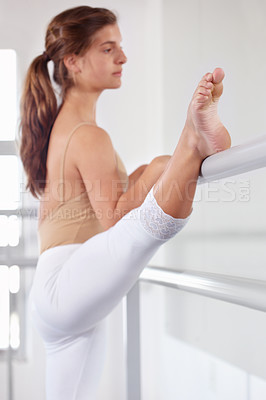 Buy stock photo A young ballerina putting in the hours in her dance studio
