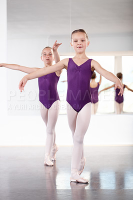 Buy stock photo Two young girls dancing in a ballet studio