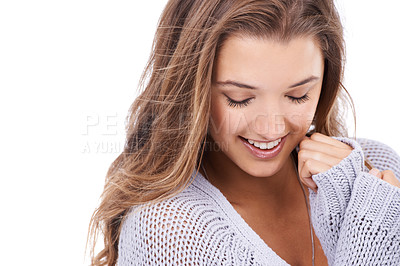 Buy stock photo A beautiful young woman smiling shyly against a white background