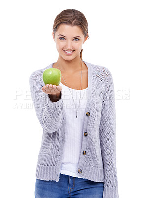 Buy stock photo A gorgeous young brunette holding an apple while isolated on a white background