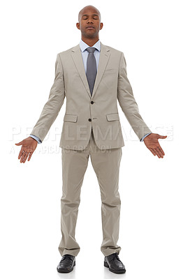 Buy stock photo An ethnic businessman standing with his eyes closed and his palms open in a meditation pose
