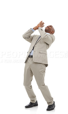 Buy stock photo An African-American businessman throwing his hands up in the air in an expression of joy