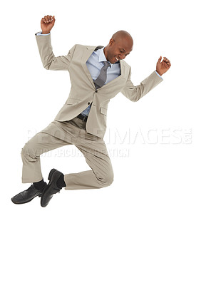 Buy stock photo An African-American businessman jumping joyfully in the air