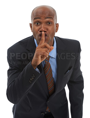 """Buy stock photo Studio portrait of an african american businessman gesturing """"shh"""" to the cmaera"""