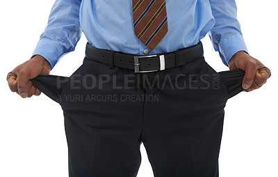 Buy stock photo Cropped closeup shot of a businessman pulling out his empty pant pockets