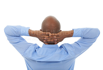 Buy stock photo Rearview studio portrait of an african american businessman with his hands behind his head
