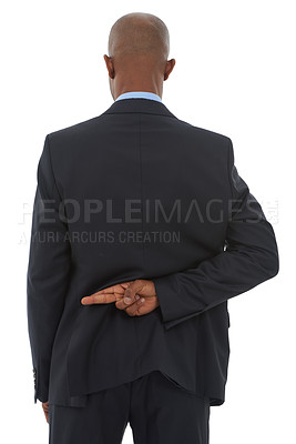 Buy stock photo An African-American businessman with his fingers crossed behind his back