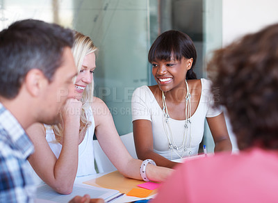Buy stock photo A creative team brainstorming in the boardroom together!