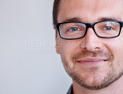 Buy stock photo Closeup shot of a handsome man wearing glasses