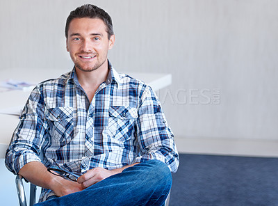 Buy stock photo A casual young man smiling at the camera