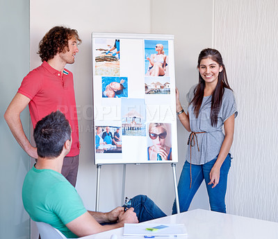 Buy stock photo Two young people pitching their ideas to a colleague in the boardroom at a modelling agency