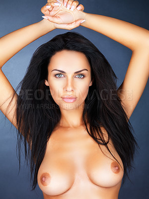 Buy stock photo Sensuous topless female holding up hands on blue background