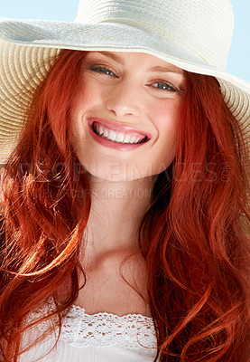 Buy stock photo A young redheade woman wearing a sunhat