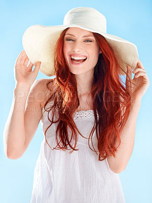 Buy stock photo A gorgeous young redheaded woman wearing a sunhat outside