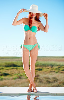 Buy stock photo A gorgeous redhead posing in the summer sun in a bikini