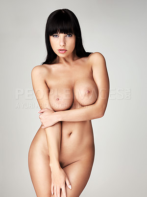 Buy stock photo A stunning woman with dark hair posing nude in a studio shoot