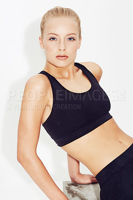 Buy stock photo A young woman posing in sportswear